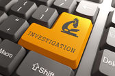 Keyboard with Investigation Orange Button. — Stock Photo