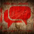 Red  Speech Bubble Icon on Wood. — Stock Photo