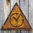 Icon of Clock Face on Rusty Warning Sign. — Stock Photo