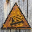 ID Card Icon on Rusty Warning Sign. — Stock Photo