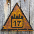 Calendar with Date Icon on Rusty Warning Sign. — Stock Photo