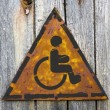 Disabled Icon on Rusty Warning Sign. — Stock Photo