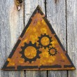 Cogwheel Gear Icon on Rusty Warning Sign. — Stock Photo