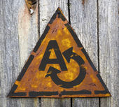 Translating Concept on Weathered Warning Sign. — Foto Stock