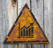 Growth Chart Icon on Rusty Warning Sign. — Stock Photo