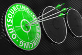 Outsourcing Concept on Green Target. — Stock Photo