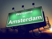 Billboard Welcome to Amsterdam at Sunrise. — Stock Photo