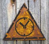 Icon of Clock Face on Rusty Warning Sign. — ストック写真