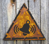 Ringing Bell Icon on Rusty Warning Sign. — Stock Photo