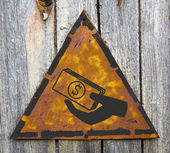 Icon of Money in the Hand on Rusty Warning Sign. — Stok fotoğraf