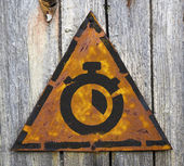 Stopwatch Icon on Rusty Warning Sign. — Stockfoto