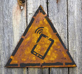 Smartphone Icon on Rusty Warning Sign. — Stock Photo