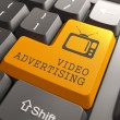 Video Advertising on Orange Keyboard Button. — Stock Photo #36772009
