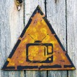 TV Set Icon on Rusty Warning Sign. — Stock Photo