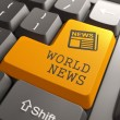 World News Concept on Orange Keyboard Button. — Stock Photo