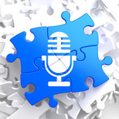 Microphone Icon on Blue Puzzle. — Stock Photo