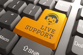 Live Support on Orange Keyboard Button. — Stock Photo