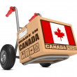 Made in Canada - Cardboard Box on Hand Truck. — Stock Photo