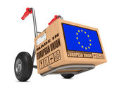 Made in EU - Cardboard Box on Hand Truck. — Stock Photo