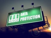Data Protection on Green Billboard at Sunrise. — Stock Photo