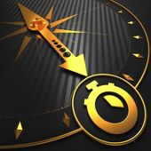 Golden Stopwatch Icon on Black Compass. — Stock Photo