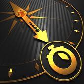 Golden Stopwatch Icon on Black Compass. — Foto de Stock