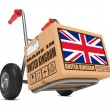 Made in UK - Cardboard Box on Hand Truck. — Stock Photo