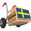 Made in Sweden - Cardboard Box on Hand Truck. — Stock Photo