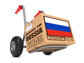 Made in Russia - Cardboard Box on Hand Truck. — Stock Photo