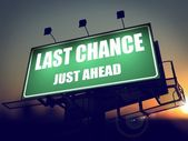 Last Chance Just Ahead on Green Billboard. — Stock Photo