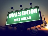 Wisdom Just Ahead on Green Billboard. — Photo