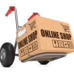 Online Shop - Cardboard Box on Hand Truck. — Stock Photo