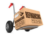 Refinancing - Cardboard Box on Hand Truck. — Stock Photo