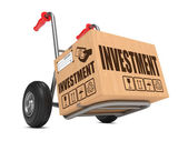 Investment - Cardboard Box on Hand Truck. — Stock Photo
