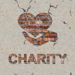 Stock Photo: Charity Concept on Brick Wall.