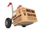 New Solution - Cardboard Box on Hand Truck. — Stock Photo