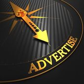 Advertise on Black and Golden Compass. — Stock Photo