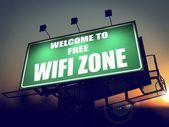 Free WiFi Zone - Billboard on the Sunrise. — Stock Photo