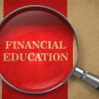 Stock Photo: Financial Education - Magnifying Glass.