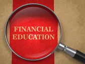 Financial Education - Magnifying Glass. — Stock Photo