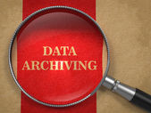 Data Archiving - Magnifying Glass. — Stock Photo