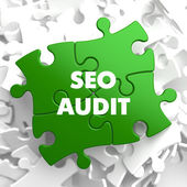 SEO Audit on Green Puzzle. — Stock Photo
