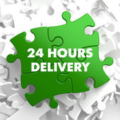 Green Puzzle with slogan - 24 hours Delivery. — Stock Photo