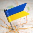 Ukraine Small Flag on a Map Background. — Stock Photo #44648493