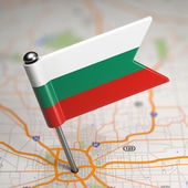 Bulgaria Small Flag on a Map Background. — Stock Photo
