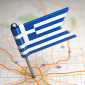 Greece Small Flag on a Map Background. — Foto Stock