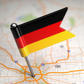 Germany Small Flag on a Map Background. — Foto Stock