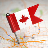 Canada Small Flag on a Map Background. — Foto de Stock