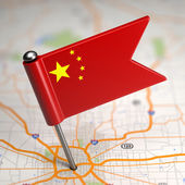 China Small Flag on a Map Background. — Stock Photo