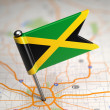 Jamaica Small Flag on a Map Background. — Stock Photo #44903677